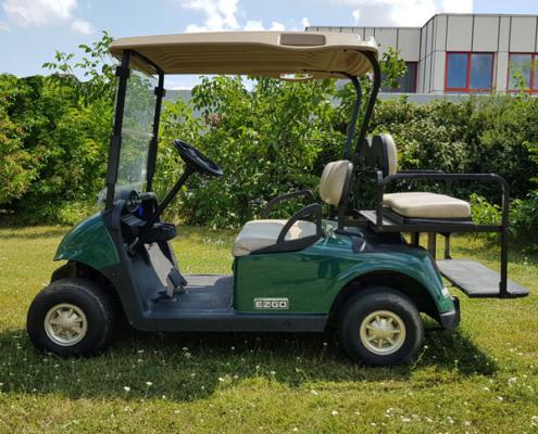 Gebrauchte-Golfcarts-EZGO-RXV-grün-FlipFlop-Seitenansicht-600x600