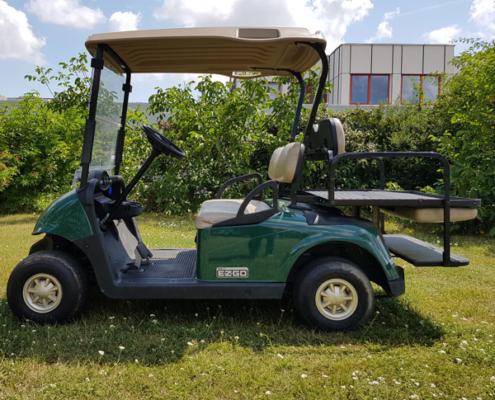 Gebrauchte-Golfcarts-EZGO-RXV-grün-FlipFlop-Seitenansicht-Ladefläche-600x600