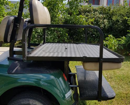 Gebrauchte-Golfcarts-EZGO-RXV-grün-FlipFlop-Seitenansicht-Ladefläche-Detail-600x600